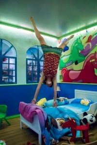 Milou jumping upside down on the bed in George Town Malaysia